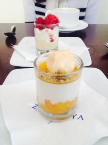 Muscat-soaked apricots, vanilla yogurt cream, apricot sorbet, pistachio powder and semolina custard espuma, crispy phyllo, almonds, berries, raspberry mastiha sorbet