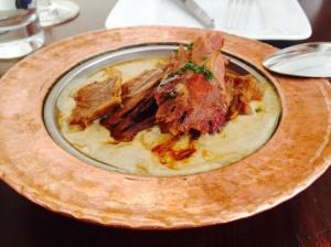 Traditional Turkish braised lamb shank, eggplant-kefalograviera puree