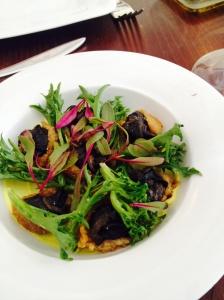 Crispy potato-crusted snails, baharat-spiced labneh, heirloom lettuces